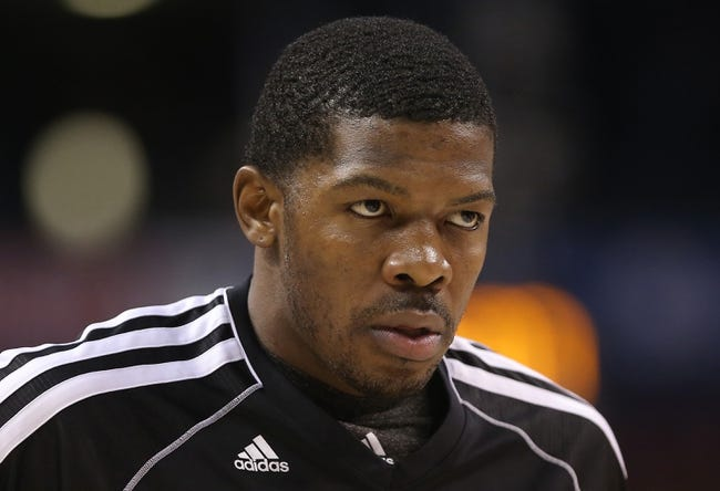 Nov 26, 2013; Toronto, Ontario, CAN; Brooklyn Nets guard Joe Johnson (7) warms up before playing against the Toronto Raptors at Air Canada Centre. The Nets beat the Raptors 102-100. Mandatory Credit: Tom Szczerbowski-USA TODAY Sports