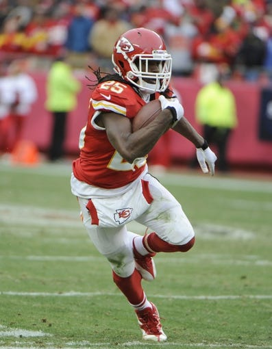Nov 24, 2013; Kansas City, MO, USA; Kansas City Chiefs running back Jamaal Charles (25) runs after a catch against the San Diego Chargers in the second half at Arrowhead Stadium. San Diego won 41-38. Mandatory Credit: John Rieger-USA TODAY Sports