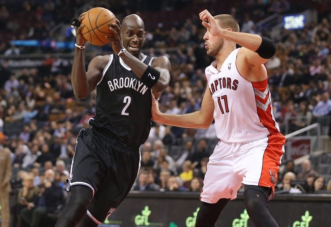 Nov 26, 2013; Toronto, Ontario, CAN; Brooklyn Nets forward Kevin Garnett (2) goes to the basket against Toronto Raptors center Jonas Valanciunas (17) at Air Canada Centre. The Nets beat the Raptors 102-100. Mandatory Credit: Tom Szczerbowski-USA TODAY Sports
