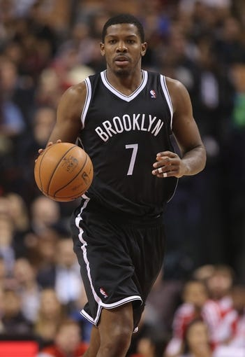Nov 26, 2013; Toronto, Ontario, CAN; Brooklyn Nets guard Joe Johnson (7) brings the ball up the court against the Toronto Raptors at Air Canada Centre. The Nets beat the Raptors 102-100. Mandatory Credit: Tom Szczerbowski-USA TODAY Sports