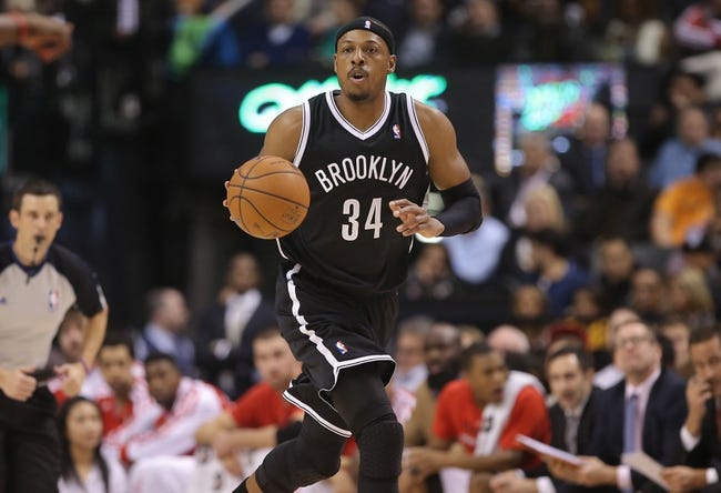 Nov 26, 2013; Toronto, Ontario, CAN; Brooklyn Nets forward Paul Pierce (34) advances the ball against the Toronto Raptors at Air Canada Centre. The Nets beat the Raptors 102-100. Mandatory Credit: Tom Szczerbowski-USA TODAY Sports
