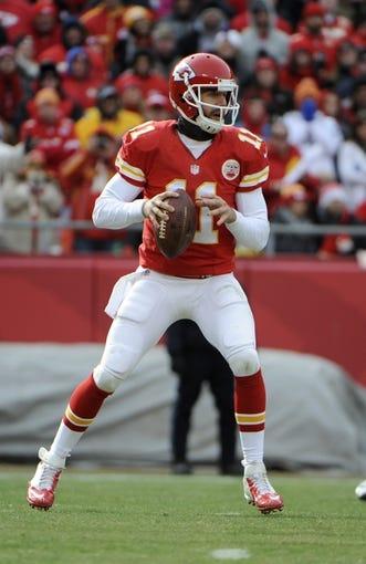 Nov 24, 2013; Kansas City, MO, USA; Kansas City Chiefs quarterback Alex Smith (11) drops back to pass against the San Diego Chargers in the first half at Arrowhead Stadium. San Diego won 41-38. Mandatory Credit: John Rieger-USA TODAY Sports