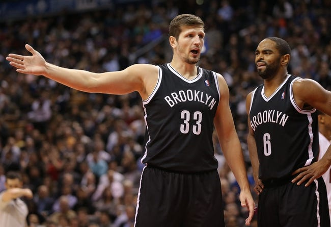 Nov 26, 2013; Toronto, Ontario, CAN; Brooklyn Nets forward Mirza Teletovic (33) argues a call with forward Alan Anderson (6) looking on against the Toronto Raptors at Air Canada Centre. The Nets beat the Raptors 102-100. Mandatory Credit: Tom Szczerbowski-USA TODAY Sports