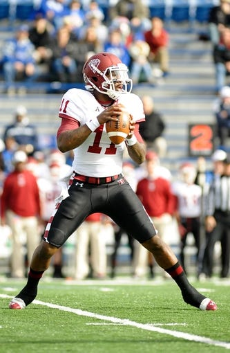 Nov 30, 2013; Memphis, TN, USA; Temple Owls quarterback P.J. Walker (11) attempts to pass the ball against the Memphis Tigers during the first quarter at Liberty Bowl Memorial. Mandatory Credit: Justin Ford-USA TODAY Sports