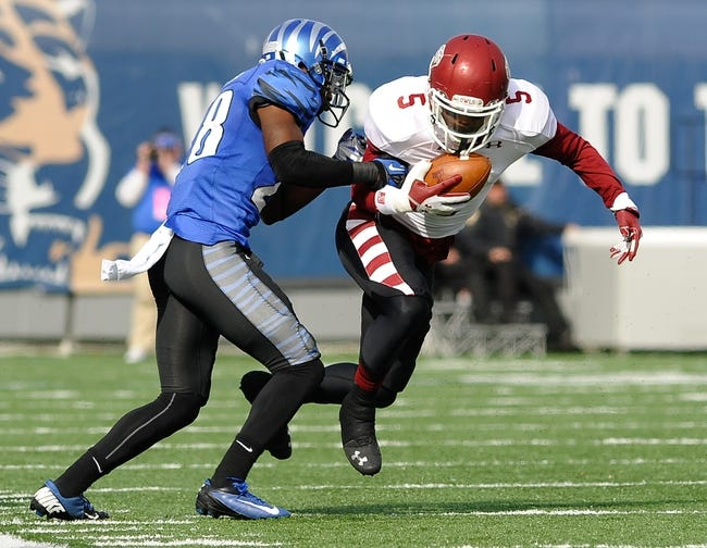 Nov 30, 2013; Memphis, TN, USA; Temple Owls wide receiver Jalen Fitzpatrick (5) carries the ball while Memphis Tigers defensive back Andrew Gaines (28) attempts to bring hime down during the first quarter at Liberty Bowl Memorial. Mandatory Credit: Justin FordUSA TODAY Sports