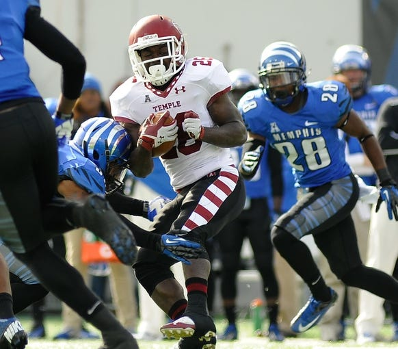 Nov 30, 2013; Memphis, TN, USA; Temple Owls running back Jamie Gilmore (26) spins around Memphis Tigers linebacker Derek Howard (29) during the first quarter at Liberty Bowl Memorial. Mandatory Credit: Justin Ford-USA TODAY Sports