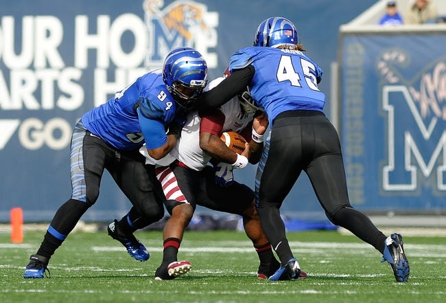 Nov 30, 2013; Memphis, TN, USA; Temple Owls quarterback P.J. Walker (11) is tackled by Memphis Tigers defensive lineman Corey Jones (94) and Memphis Tigers linebacker Anthony Brown (45) during the first quarter at Liberty Bowl Memorial. Mandatory Credit: Justin Ford-USA TODAY Sports