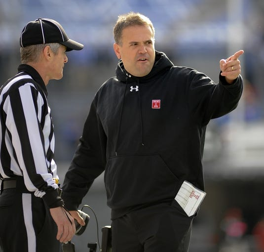 Nov 30, 2013; Memphis, TN, USA; Temple Owls head coach Matt Rhule talks to referee during a time out against the Memphis Tigers  during the first quarter at Liberty Bowl Memorial. Mandatory Credit: Justin Ford-USA TODAY Sports