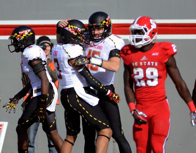 Nov 30, 2013; Raleigh, NC, USA; Maryland Terrapins quarterback C.J. Brown (16) is congratulated by teammate Nigel King (3) after a first half touchdown against the North Carolina State Wolfpack at Carter Finley Stadium. Mandatory Credit: Rob Kinnan-USA TODAY Sports