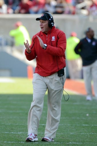 Nov 30, 2013; Raleigh, NC, USA; North Carolina State Wolfpack head coach Dave Doeren encourages his team during the first half against the Maryland Terrapins at Carter Finley Stadium. Mandatory Credit: Rob Kinnan-USA TODAY Sports
