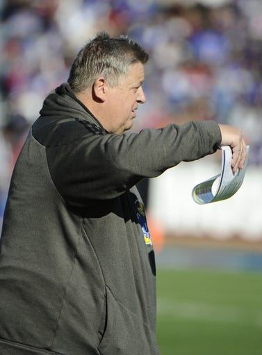 Nov 30, 2013; Lawrence, KS, USA; Kansas Jayhawks head coach Charlie Weis on the sidelines against the Kansas State Wildcats in the first half at Memorial Stadium. Mandatory Credit: John Rieger-USA TODAY Sports