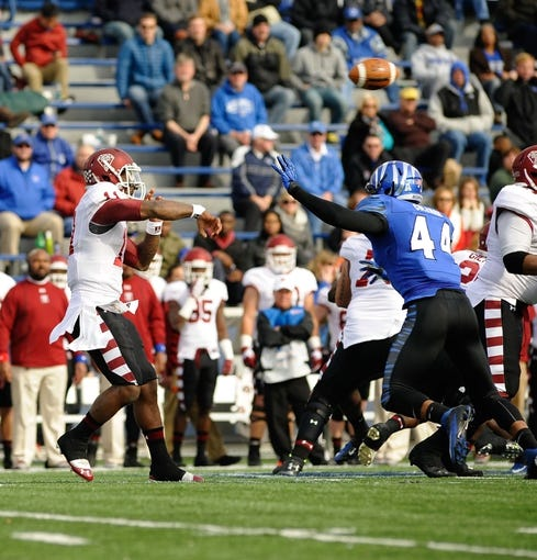 Nov 30, 2013; Memphis, TN, USA; Memphis Tigers linebacker Ryan Coleman (44) rushes Temple Owls quarterback P.J. Walker (11) as he throws the ball during the third quarter at Liberty Bowl Memorial. Mandatory Credit: Justin Ford-USA TODAY Sports