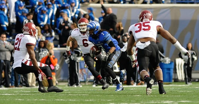 Nov 30, 2013; Memphis, TN, USA; Memphis Tigers wide receiver Keiwone Malone (7) rushes the ball against Temple Owls defensive back Abdul Smith (21), linebacker Nate D. Smith (35) and linebacker Blaze Caponegro (6) during the third quarter at Liberty Bowl Memorial. Mandatory Credit: Justin Ford-USA TODAY Sports