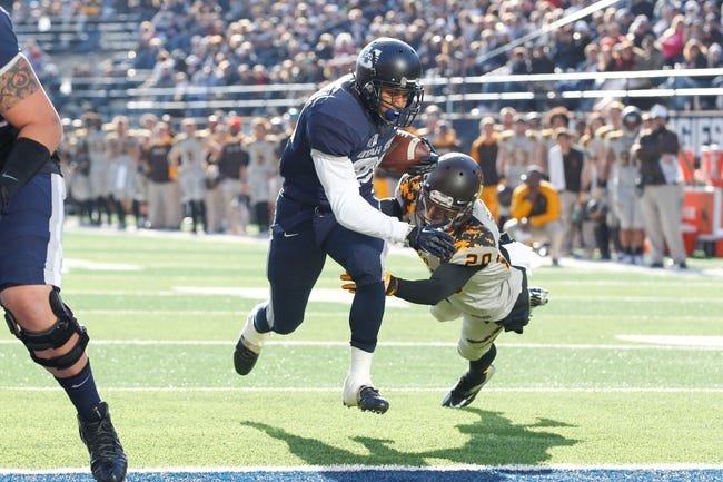 Nov 30, 2013; Logan, UT, USA; Utah State Aggies running back Joey DeMartino (28) runs past a diving Wyoming Cowboys cornerback Blair Burns (20) scoring a touchdown during the second quarter at Romney Stadium. Mandatory Credit: Chris Nicoll-USA TODAY Sports