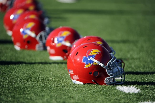 Nov 30, 2013; Lawrence, KS, USA; Kansas Jayhawks helmets sit on the field before the game against the Kansas State Wildcats at Memorial Stadium. Kansas State won the game 31-10. Mandatory Credit: John Rieger-USA TODAY Sports