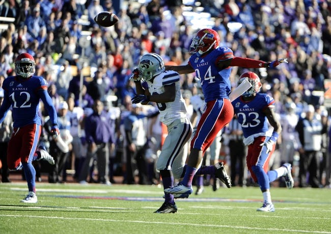Nov 30, 2013; Lawrence, KS, USA; Kansas Jayhawks cornerback JaCorey Shepherd (24) breaks up a pass intended for Kansas State Wildcats wide receiver Tyler Lockett (16) in the second half at Memorial Stadium. Kansas State won the game 31-10. Mandatory Credit: John Rieger-USA TODAY Sports
