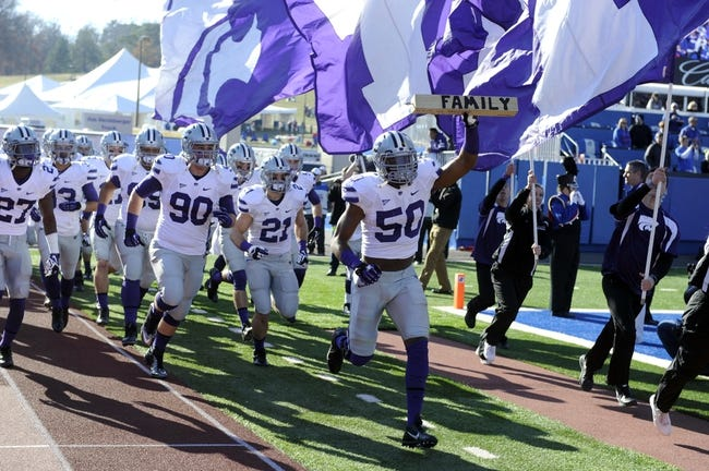 Nov 30, 2013; Lawrence, KS, USA; Kansas State Wildcats linebacker Tre Walker (50) leads the team onto the field before the game against the Kansas Jayhawks at Memorial Stadium. Kansas State won the game 31-10. Mandatory Credit: John Rieger-USA TODAY Sports