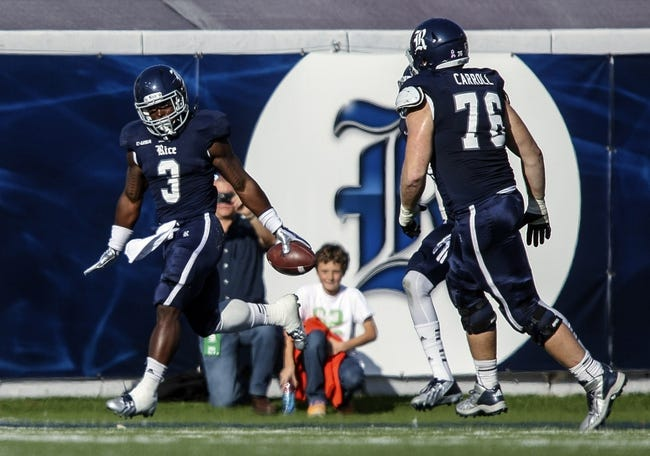 Nov 30, 2013; Houston, TX, USA; Rice Owls running back Jawon Davis (3) celebrates after scoring a touchdown during the second quarter against the Tulane Green Wave at Rice Stadium. Mandatory Credit: Troy Taormina-USA TODAY Sports