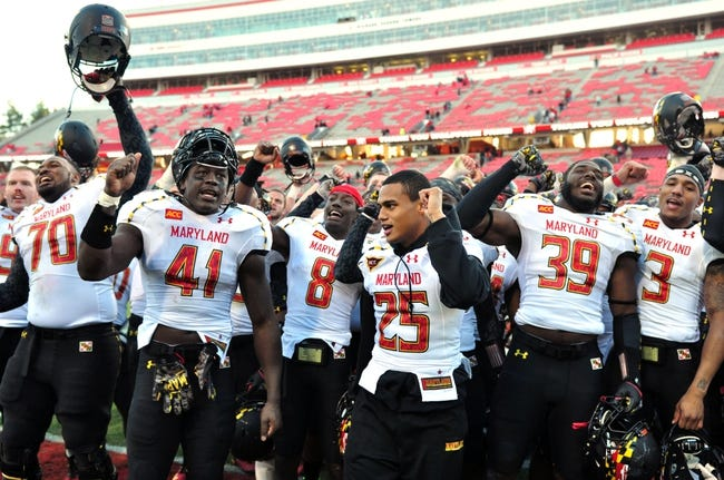 Nov 30, 2013; Raleigh, NC, USA; Maryland Terrapins players De'Onte Arnett (70) , Marcus Whitfield (41) , Levern Jacobs (8) , Dexter McDougle (25) , Cavon Walker (39) and Nigel King (3) celebrate a win over the North Carolina State Wolfpack at Carter Finley Stadium.  Maryland won 41-21.  Mandatory Credit: Rob Kinnan-USA TODAY Sports