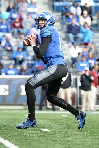 Nov 30, 2013; Memphis, TN, USA; Memphis Tigers quarterback Paxton Lynch (12) attempts to pass against the Temple Owls during the second half at Liberty Bowl Memorial. Temple Owls beat the Memphis Tigers 41-21. Mandatory Credit: Justin Ford-USA TODAY Sports