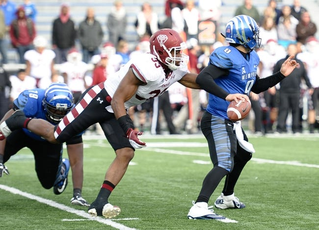Nov 30, 2013; Memphis, TN, USA; Temple Owls linebacker Haason Reddick (33) tries to bring down Memphis Tigers quarterback Jacob Karam (9) during the second half at Liberty Bowl Memorial. Temple Owls beat the Memphis Tigers 41-21. Mandatory Credit: Justin Ford-USA TODAY Sports