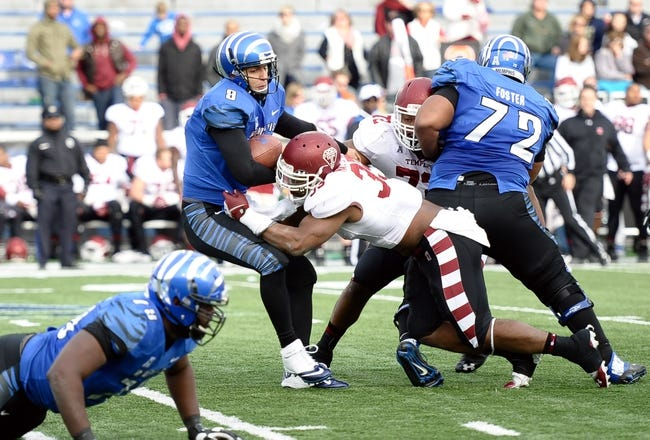 Nov 30, 2013; Memphis, TN, USA; Temple Owls linebacker Haason Reddick (33) sacks Memphis Tigers quarterback Jacob Karam (9) during the second half at Liberty Bowl Memorial. Temple Owls beat the Memphis Tigers 41-21. Mandatory Credit: Justin Ford-USA TODAY Sports