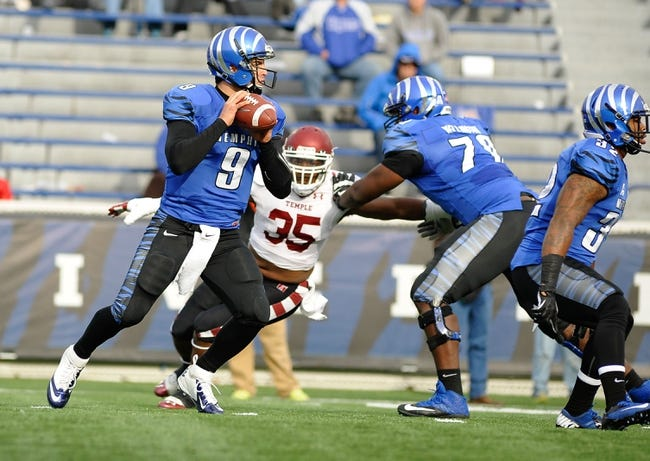 Nov 30, 2013; Memphis, TN, USA; Memphis Tigers quarterback Jacob Karam (9) during the game against the Temple Owls during the second half at Liberty Bowl Memorial. Temple Owls beat the Memphis Tigers 41-21. Mandatory Credit: Justin Ford-USA TODAY Sports