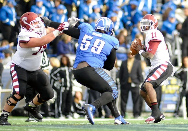 Nov 30, 2013; Memphis, TN, USA; Temple Owls quarterback P.J. Walker (11)  passes against the Memphis Tigers during the second half at Liberty Bowl Memorial. Temple Owls beat the Memphis Tigers 41-21. Mandatory Credit: Justin Ford-USA TODAY Sports