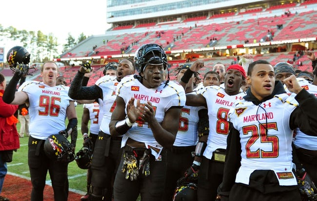 Nov 30, 2013; Raleigh, NC, USA; Maryland Terrapins players Scott Thompson (96) , De'Onte Arnett (70) , Marcus Whitfield (41) , Levern Jacobs (8) and Dexter McDougle (25) celebrate a win over the North Carolina State Wolfpack at Carter Finley Stadium.  Maryland won 41-21.  Mandatory Credit: Rob Kinnan-USA TODAY Sports