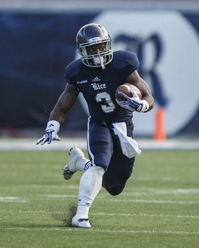 Nov 30, 2013; Houston, TX, USA; Rice Owls running back Jawon Davis (3) runs with the ball during the second quarter against the Tulane Green Wave at Rice Stadium. Mandatory Credit: Troy Taormina-USA TODAY Sports