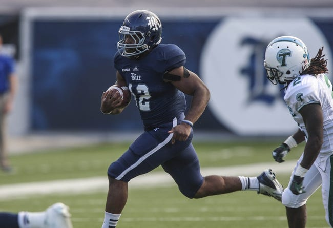 Nov 30, 2013; Houston, TX, USA; Rice Owls running back Charles Ross (12) runs with the ball during the second quarter against the Tulane Green Wave at Rice Stadium. Mandatory Credit: Troy Taormina-USA TODAY Sports