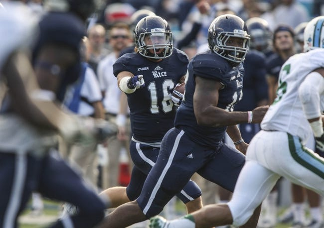 Nov 30, 2013; Houston, TX, USA; Rice Owls quarterback Taylor McHargue (16) runs with the ball during the second quarter against the Tulane Green Wave at Rice Stadium. Mandatory Credit: Troy Taormina-USA TODAY Sports