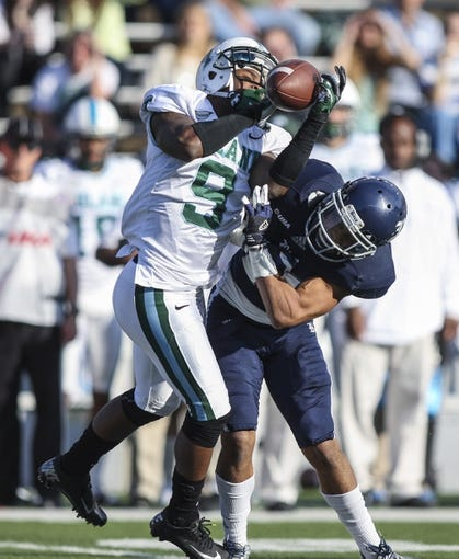 Nov 30, 2013; Houston, TX, USA; Tulane Green Wave wide receiver Kedrick Banks (9) makes a reception during the second quarter as Rice Owls cornerback Bryce Callahan (29) defends at Rice Stadium. Mandatory Credit: Troy Taormina-USA TODAY Sports