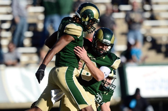 Nov 30, 2013; Fort Collins, CO, USA; Colorado State Rams wide receiver Jordon Vaden (11) is congratulated for his touchdown reception by quarterback Garrett Grayson (18) in the third quarter against the Air Force Falcons at Hughes Stadium. The Rams defeated the Falcons 58-0. Mandatory Credit: Ron Chenoy-USA TODAY Sports