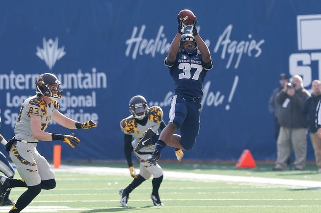Nov 30, 2013; Logan, UT, USA; Utah State Aggies cornerback Devin Centers (37) grabs the ball off a Wyoming Cowboys punt during the third quarter at Romney Stadium. Utah State Aggies won the game 35-7. Mandatory Credit: Chris Nicoll-USA TODAY Sports