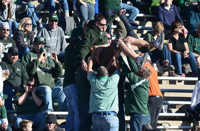 Nov 30, 2013; Fort Collins, CO, USA; Colorado State Rams fans body surf following a score in the third quarter against the Air Force Falcons at Hughes Stadium. The Rams defeated the Falcons 58-13. Mandatory Credit: Ron Chenoy-USA TODAY Sports