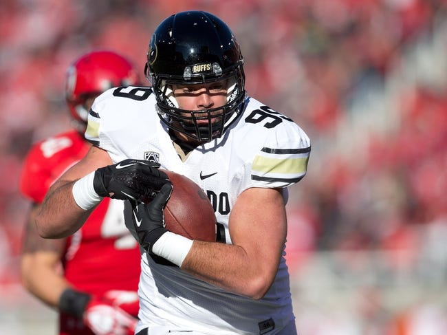Nov 30, 2013; Salt Lake City, UT, USA; Colorado Buffaloes tight end Scott Fernandez (99) runs for a touchdown after a reception during the second half against the Utah Utes at Rice-Eccles Stadium. Utah won 24-17. Mandatory Credit: Russ Isabella-USA TODAY Sports