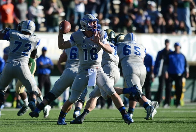 Nov 30, 2013; Fort Collins, CO, USA; Air Force Falcons quarterback Karson Roberts (16) prepares to pass in the fourth quarter against the Colorado State Rams at Hughes Stadium. The Rams defeated the Falcons 58-13. Mandatory Credit: Ron Chenoy-USA TODAY Sports