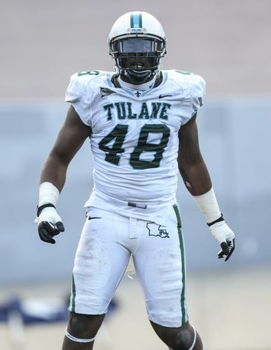 Nov 30, 2013; Houston, TX, USA; Tulane Green Wave defensive end Royce LaFrance (48) reacts after getting a sack during the third quarter against the Rice Owls at Rice Stadium. Mandatory Credit: Troy Taormina-USA TODAY Sports