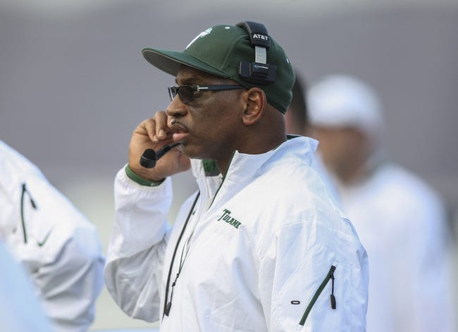 Nov 30, 2013; Houston, TX, USA; Tulane Green Wave head coach Curtis Johnson coaches from the sideline during the third quarter against the Rice Owls at Rice Stadium. Mandatory Credit: Troy Taormina-USA TODAY Sports