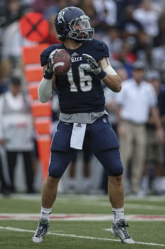 Nov 30, 2013; Houston, TX, USA; Rice Owls quarterback Taylor McHargue (16) looks for an open receiver during the third quarter against the Tulane Green Wave at Rice Stadium. Mandatory Credit: Troy Taormina-USA TODAY Sports