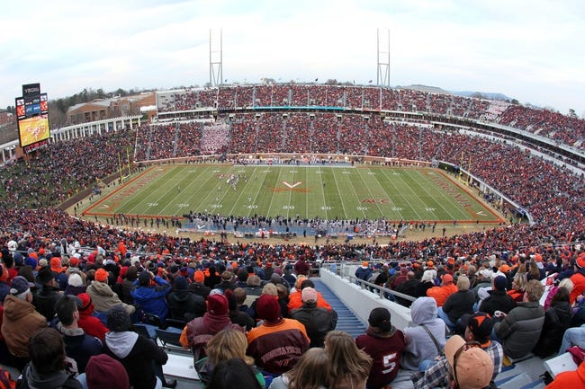 Nov 30, 2013; Charlottesville, VA, USA; A general view of the game between the Virginia Tech Hokies and the Virginia Cavaliers in the first quarter at Scott Stadium. The Hokies won 16-6. Mandatory Credit: Geoff Burke-USA TODAY Sports