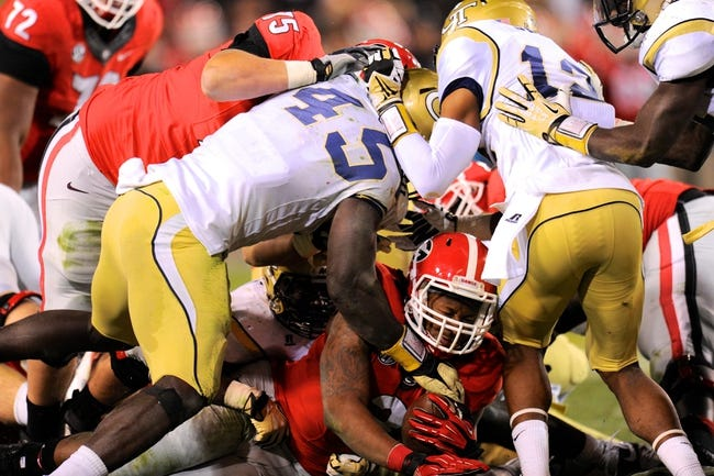 Nov 30, 2013; Atlanta, GA, USA; Georgia Bulldogs running back Todd Gurley (3) is tackled short of the goal line by the Georgia Tech Yellow Jackets during the fourth quarter at Bobby Dodd Stadium. Georgia defeated Georgia Tech 41-34 in overtime. Mandatory Credit: Dale Zanine-USA TODAY Sports