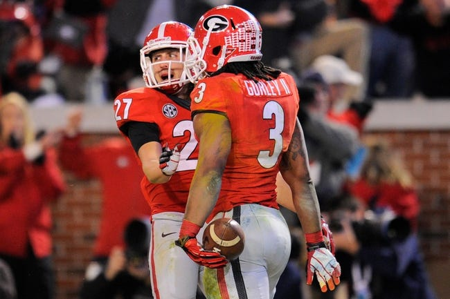 Nov 30, 2013; Atlanta, GA, USA; Georgia Bulldogs running back Todd Gurley (3) reacts with wide receiver Rhett McGowan (27) after scoring a touchdown against the Georgia Tech Yellow Jackets during overtime at Bobby Dodd Stadium. Georgia defeated Georgia Tech 41-34 in overtime. Mandatory Credit: Dale Zanine-USA TODAY Sports