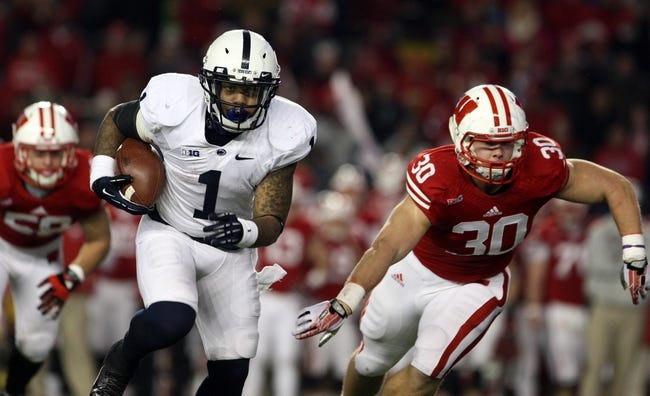 Nov 30, 2013; Madison, WI, USA; Penn State Nittany Lions running back Bill Belton (1) rushes for yardage as Wisconsin Badgers linebacker Derek Landisch (1) defends at Camp Randall Stadium. Penn State defeated Wisconsin 31-24. Mandatory Credit: Mary Langenfeld-USA TODAY Sports