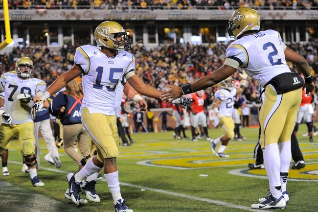 Nov 30, 2013; Atlanta, GA, USA; Georgia Tech Yellow Jackets wide receiver DeAndre Smelter (15) shakes hands with quarterback Vad Lee (2) after catching a touchdown against the Georgia Bulldogs during the second half at Bobby Dodd Stadium. Georgia defeated Georgia Tech 41-34 in overtime. Mandatory Credit: Dale Zanine-USA TODAY Sports