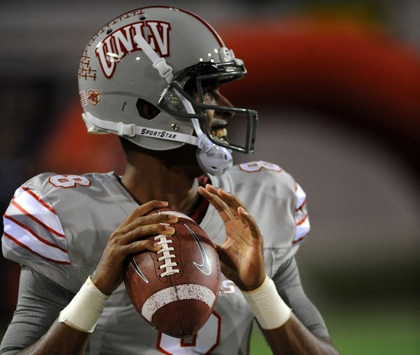 Nov 30, 2013; Las Vegas, NV, USA; UNLV Rebels quarterback Caleb Herring warms up before an NCAA football game against the San Diego State Aztecs at Sam Boyd Stadium. Mandatory Credit: Stephen R. Sylvanie-USA TODAY Sports