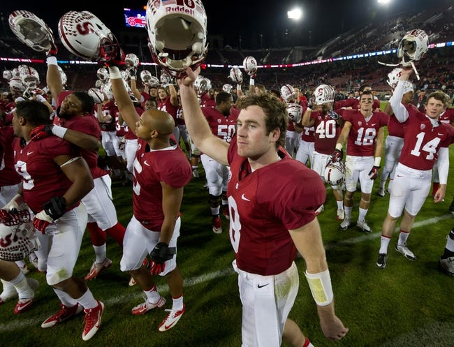 Nov 30, 2013; Stanford, CA, USA; Stanford Cardinal quarterback Kevin Hogan (8) celebrates after Stanford defeated the Notre Dame Fighting Irish 27-20 at Stanford Stadium. Mandatory Credit: Matt Cashore-USA TODAY Sports