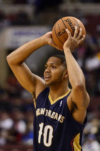 Nov 29, 2013; Philadelphia, PA, USA; New Orleans Pelicans guard Eric Gordon (10) looks to pass during the first quarter against the Philadelphia 76ers at the Wells Fargo Center. The Pelicans defeated the Sixers 121-105. Mandatory Credit: Howard Smith-USA TODAY Sports