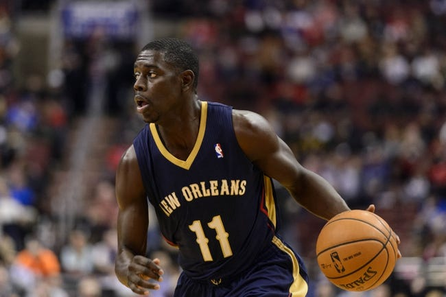 Nov 29, 2013; Philadelphia, PA, USA; New Orleans Pelicans guard Jrue Holiday (11) brings the ball up court during the first quarter against the Philadelphia 76ers at the Wells Fargo Center. The Pelicans defeated the Sixers 121-105. Mandatory Credit: Howard Smith-USA TODAY Sports